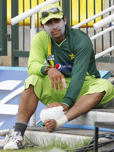 Umar Akmal puts ice on his foot during a practice session ahead of Monday's World Cup match against Zimbabwe