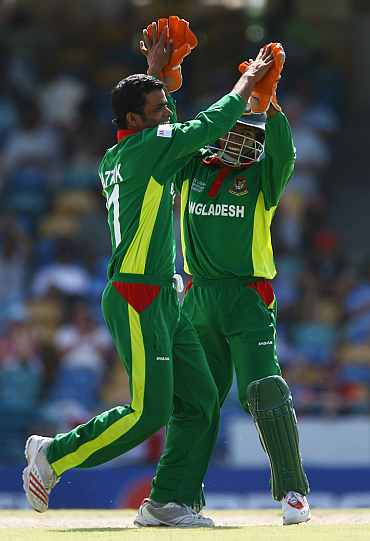 Abdur Razzak celebrates after the fall of a wicket