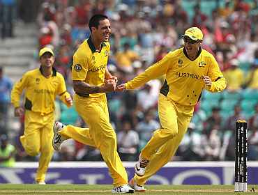 Mitchell Johnson celebrates after claiming a wicket