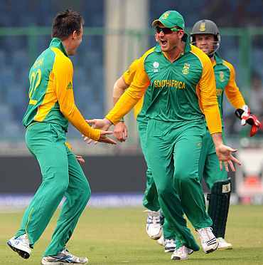 Graeme Smith celebrates with Johan Botha after a fall of a wicket