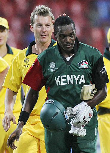 Australia's Brett Lee consoles Kenya's Collins Obuya (right) after Australia defeated Kenya on Sunday