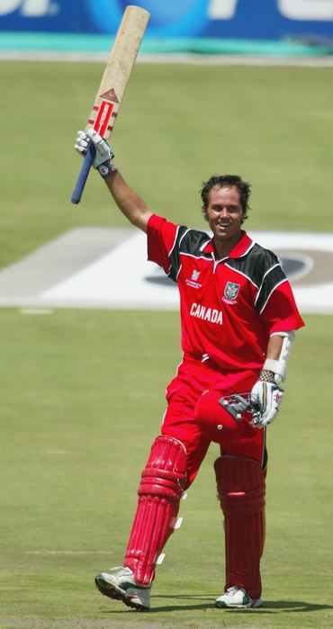Canada's John Davison celebrates after scoring the fastest hundred in World Cup history during the Pool B match between West Indies and Canada on February 23, 2003