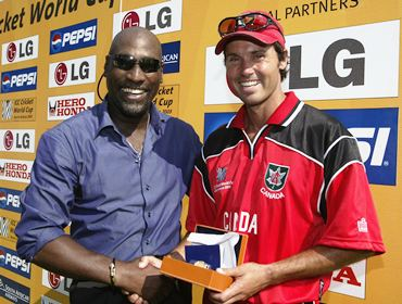 Former West Indies captain Viv Richards presents the Man of the Match award to John Davison after 2003 World Cup Pool B match between West Indies and Canada