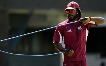Chris Gayle goes through a harness exercise during training