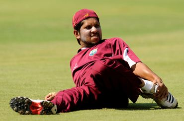 Ramnaresh Sarwan stretches during a training session