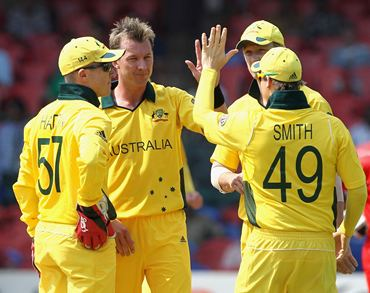 Brett Lee is congratulated by teammates after picking a wicket
