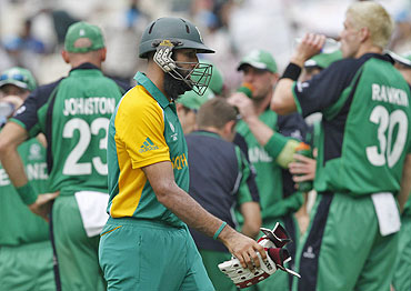 South Africa's Hashim Amla walks off the field after his dismissal