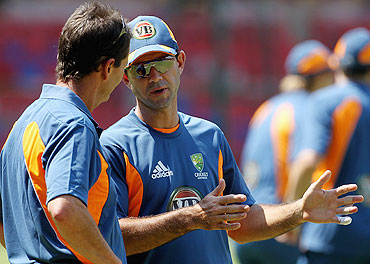 Ricky Ponting (right) speaks with chairman of selectors Andrew Hilditch during a nets session