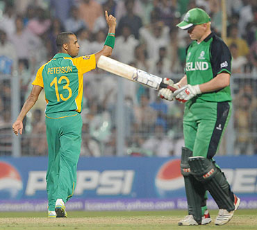 Robin Peterson of South Africa celebrates the wicket of Kevin O'Brien of Ireland