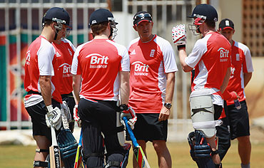 England coach Andy Flower has a chat with his batsmen during a practice session