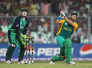 South Africa's JP Duminy plays a shot as Ireland's Nail O'Brien looks on