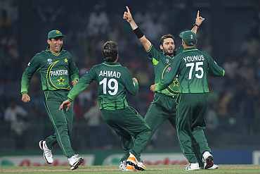 Pakistan's Shahid Afridi celebrates with teammates after picking up a wicket