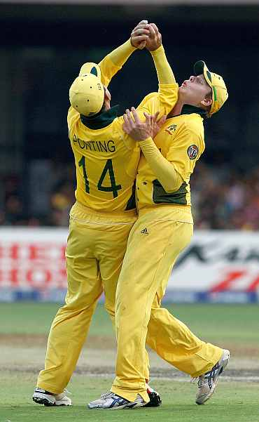 Ricky Ponting (R) of Australia collides with team mate Steven Smith as he takes a catch to dismiss Harvir Baidwan of Canada