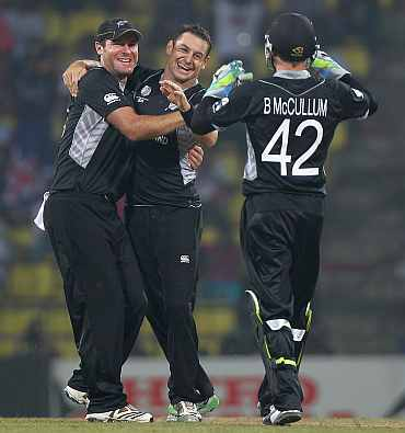 Nathan McCullum celebrates after picking up a wicket
