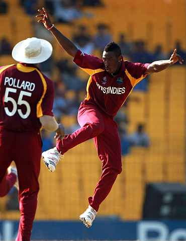 West Indies' Andre Russell celebrates taking the wicket of Ravi Bopara