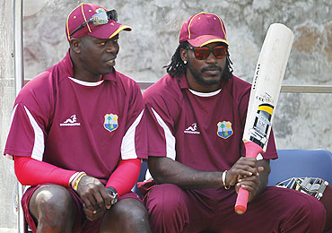 West Indies' Chris Gayle talks with coach Ottis Gibson (left)