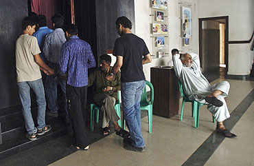 People queue up to enter a cinema hall in Karachi