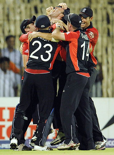 England's players celebrate after defeating the West Indies