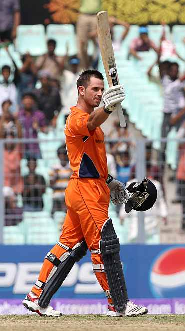 Ryan Ten Doeschate celebrates after completing his century against Ireland