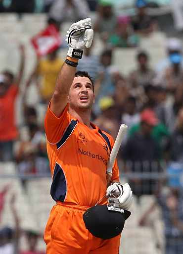 Ryan ten Doeschate reacts after completing his century