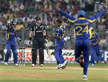 Nuwan Kulasekara celebrates after picking the wicket of Martin Guptill