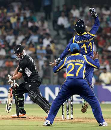 Kumar Sangakkara celebrates after taking Jesse Ryder's catch