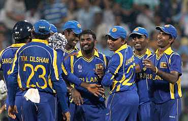 Sri Lanka's Muttiah Muralitharan celebrates after picking up a New Zealand wicket