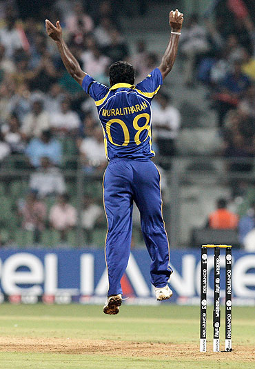 Muttiah Muralidaran of Sri Lanka jumps high despite a strained hamstring to catch Scott Styris