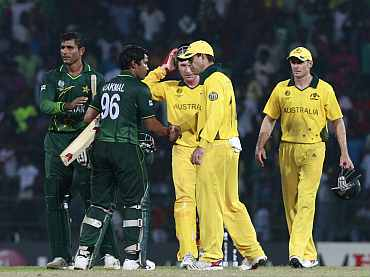 Umar Akmal is congratulated by Aussie players after the World Cup match in Colombo