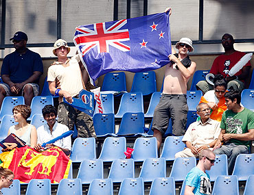 Supporters of New Zealand hold up a flag during the match between New Zealand and Sri Lanka at  the Wankhede Stadium on Friday