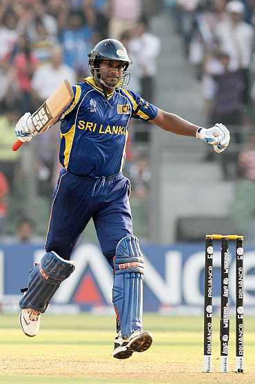 Kumar Sangakkara celebrates after completing his century