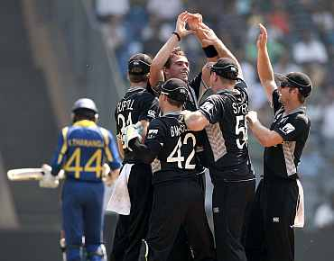 Tim Southee celebrates after picking the wicket of Upul Tharanga