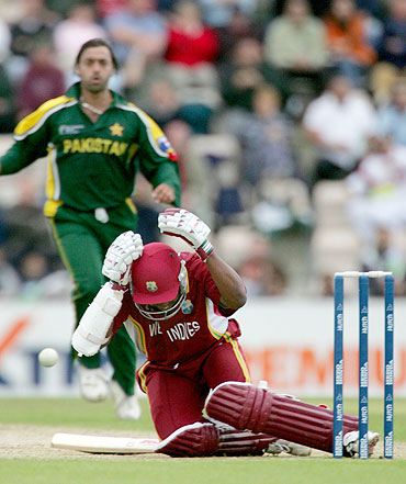 Brian Lara goes down after being hit by a Shoaib Akhtar delivery during their ICC Champions Trophy match in 2004