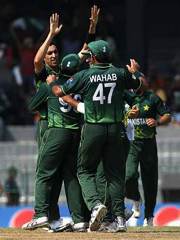 Umar Gul celebrates after picking an Australian wicket