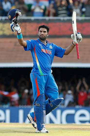 Yuvraj Singh ceclebrates after completing his century against West Indies
