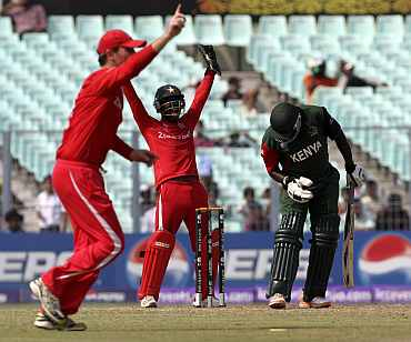 Zimbabwean players appeal for a Kenya wicket during their match in Kolkata