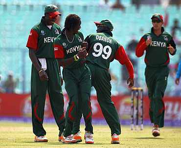 Nehemiah Odhiambo (c)of Kenya celebrates the wicket of Regis Chakabva of Zimbabwe