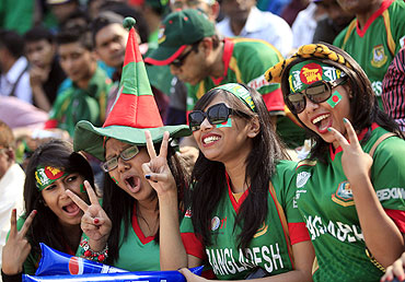 Bangladesh fans cheer during the match between India and Bangladesh