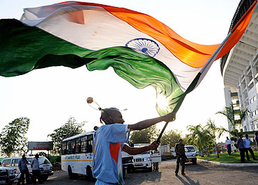An India fan waves the national flag at the VCA stadium ahead of the match between India and SA