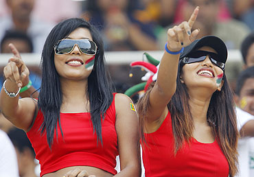 Sri Lanka cricket fans dance in the stands during Sri Lanka's match against Pakistan