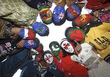 School children with their faces painted in the colours of national flags