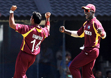 Ravi Rampaul (left) and captain Dareen Sammy celebrate after the dismissal of Sachin Tendulkar