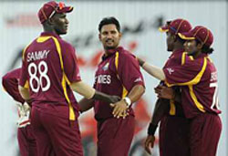 Ravi Rampaul celebrates after picking up a wicket