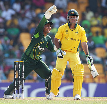 Ricky Ponting (right) is caught behind by Kamran Akmal off the bowling of Mohammad Hafeez