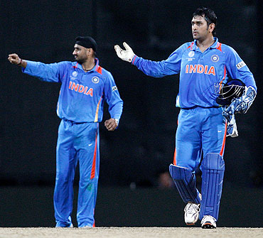 Mahendra Singh Dhoni (right) and Harbhajan Singh