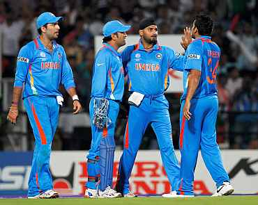 MS Dhoni celebrates after a fall of a wicket