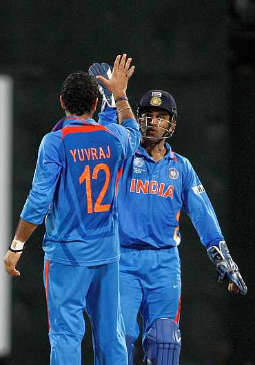 MS Dhoni celebrates with Yuvraj Singh