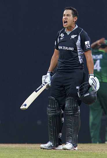 Ross Taylor celebrates with teammates after the Kiwis beat Pakistan