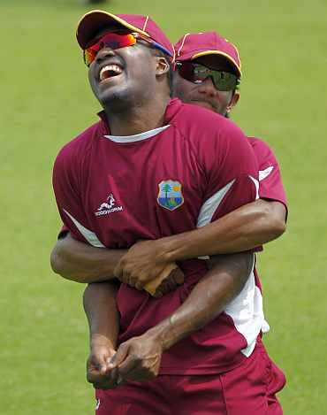 West Indies' Darren Barvo and Bishoo during a training session