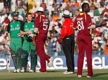 Ireland's Gary Wilson speaks to umpire after he was given out by on-field umpire Asoka de Silva during a match against West Indies